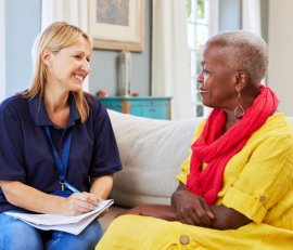caregiver and elderly woman having a conversation