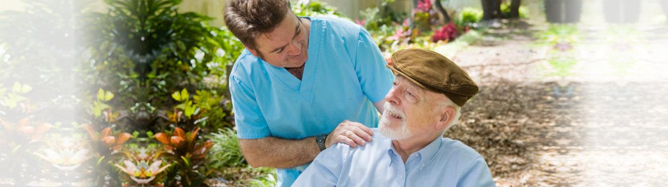 caregiver looking at elderly man