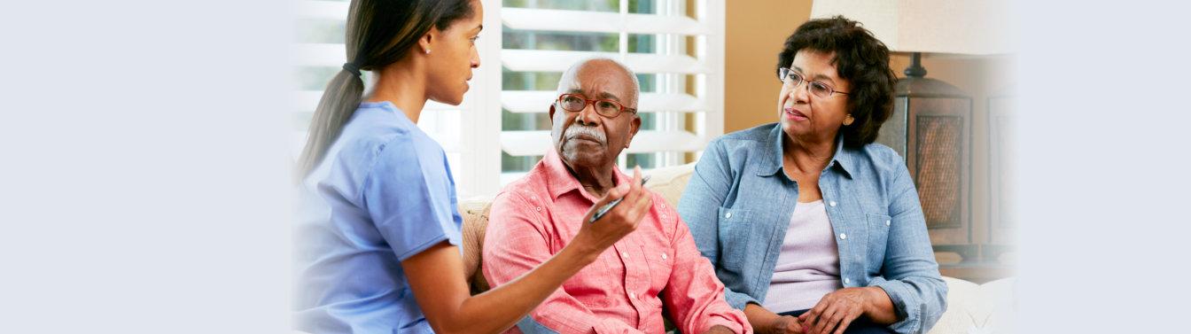 caregiver talking to elderly people