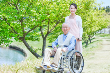 elderly woman outdoors with his caregiver