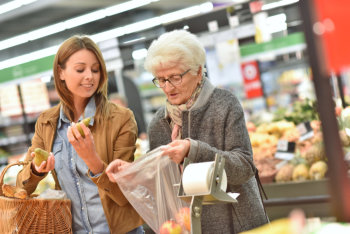 caregiver and elderly woman doing shopping